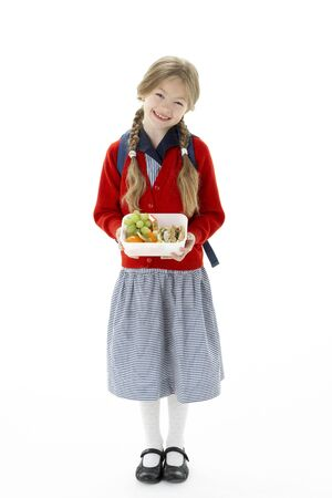 bunches: Studio Portrait of Smiling Girl Holding Lunchbox