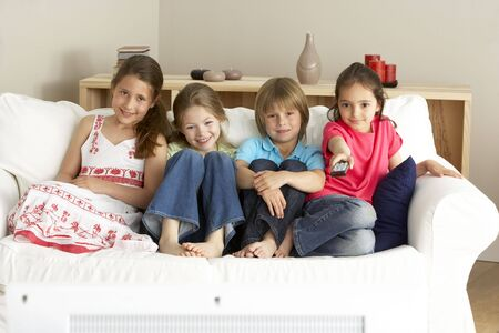 Young Children Watching Television at Home photo