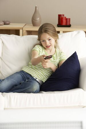 Young Girl Watching Television at Home photo