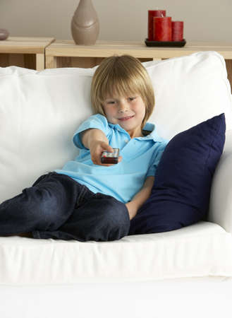 Young Boy Watching Television at Home photo