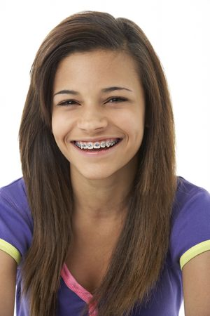 braces: Studio Portrait of Smiling Teenage Girl Stock Photo