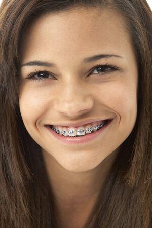 cute braces: Studio Portrait of Smiling Teenage Girl Stock Photo