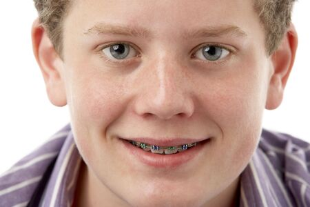 freckles: Studio Portrait of Smiling Teenage Boy Stock Photo