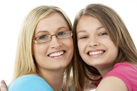 thirtys: Studio Portrait of Smiling Teenage Girl with older Sister Stock Photo