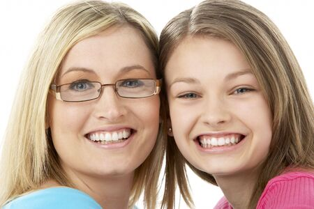 thirty's: Studio Portrait of Smiling Teenage Girl with older Sister Stock Photo