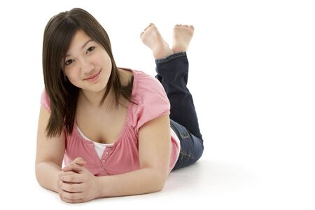 Teenage Girl Laying on Stomach Stock Photo - 5631021