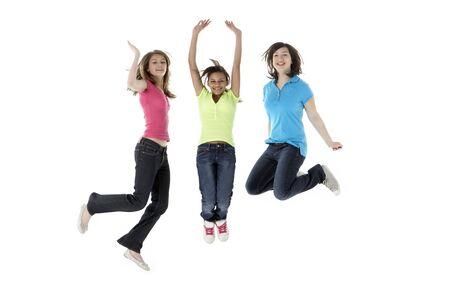 Group of Teenage Girlfriends Jumping in Studio photo