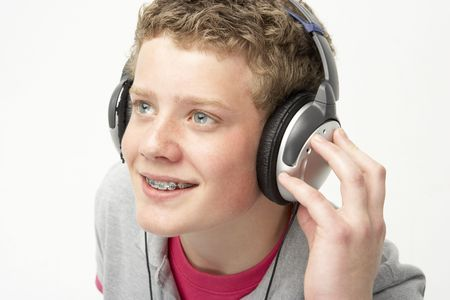 Portrait of Smiling Teenage Boy Listening to Music photo