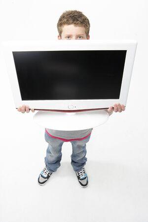 Portrait of Smiling Teenage Boy Holding Television photo