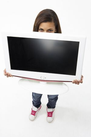 carry out: Portrait of Smiling Teenage Girl Holding Television Stock Photo