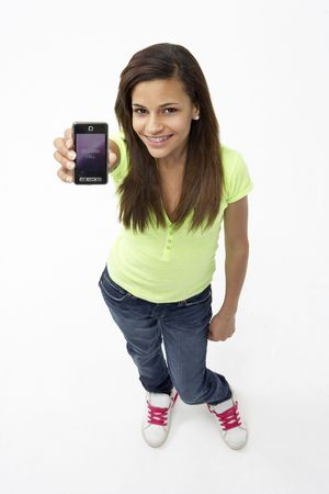 Portrait of Smiling Teenage Girl Holding Mobile Phone photo