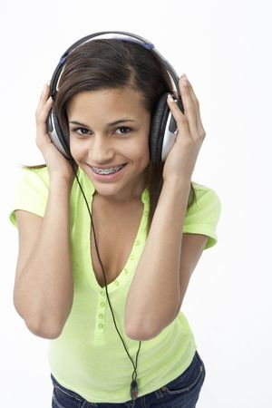 Portrait of Smiling Teenage Girl Listening to Music photo