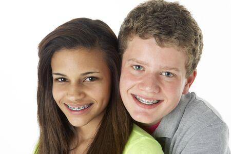 young boy smiling: Teenage Couple in Studio