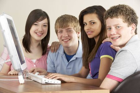 four year olds: Teenagers on Computer at Home Stock Photo