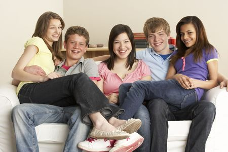 13 14 years: Teenage Friends Relaxing at Home Stock Photo