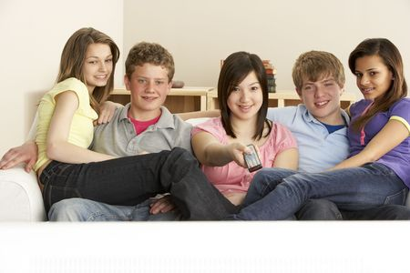 Teenage Friends Watching Television at Home photo