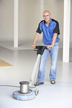 Cleaner polishing office floor Stock Photo - 5631969