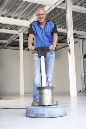 Cleaner polishing office floor photo