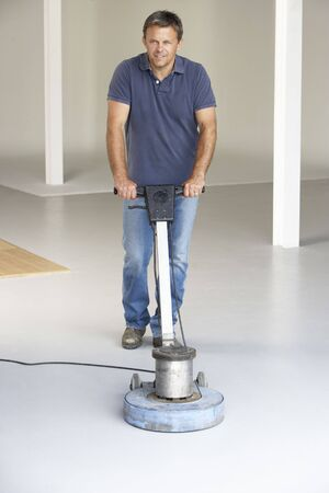 Cleaner polishing office floor Stock Photo - 5631275