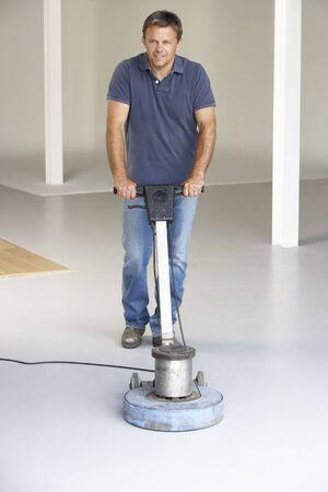 Cleaner polishing office floor Stock Photo - 5631275
