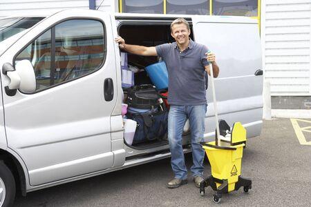 Cleaner standing next to van photo
