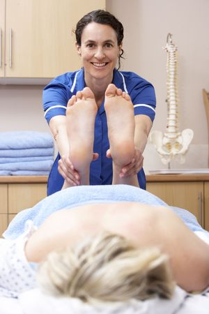 osteopath: Osteopath treating female client