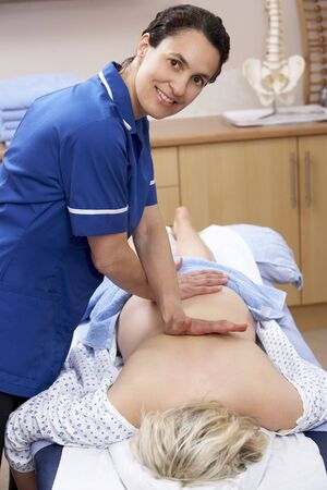 treating: Osteopath treating female client
