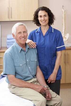 Portrait of male and female osteopath photo