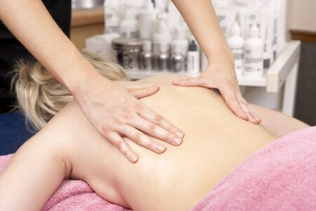 Close Up of female masseuse with client photo
