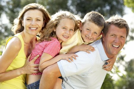 Family having fun in countryside photo