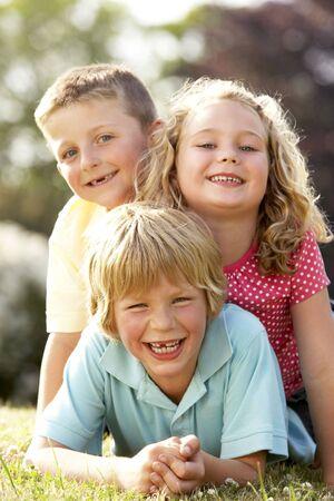 Children having fun in countryside photo