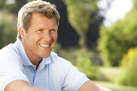 Portrait of young man relaxing in countryside photo