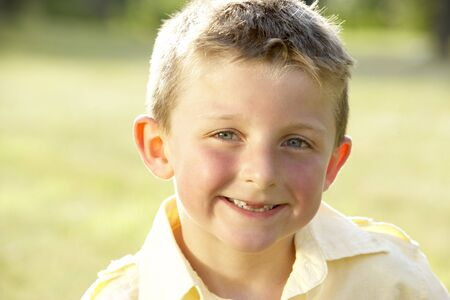 Portrait of young boy in countryside photo