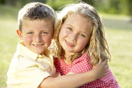 2 Children hugging outdoors photo