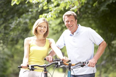 Couple riding bikes in countryside photo
