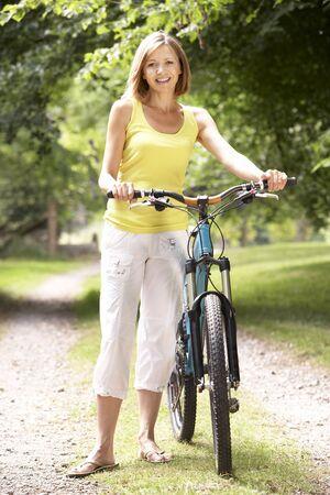 Woman riding bike in countryside Stock Photo - 5631708