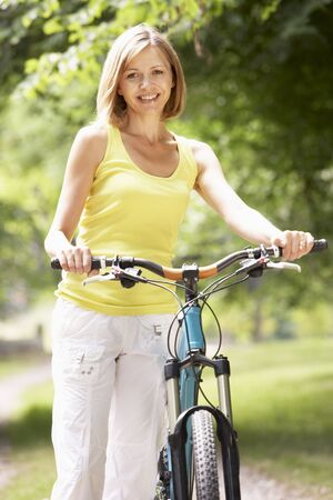 Woman riding bike in countryside Stock Photo - 5632858