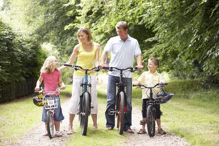 Family riding bikes in countryside Stock Photo - 5633084