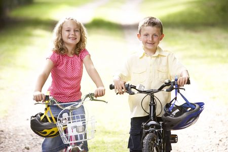 Children riding bikes in countryside photo
