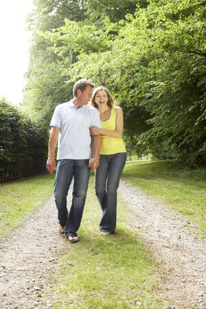 walking in park: Middle aged couple walking in countryside