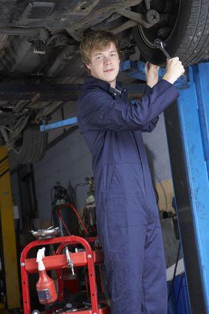 Mechanic working on car photo