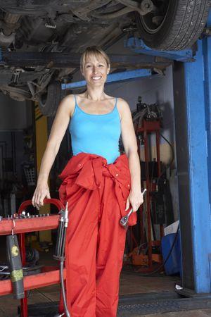 Female mechanic working on car photo