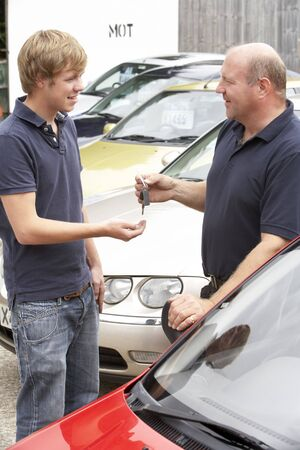 a lot of money: Young man collecting new car Stock Photo