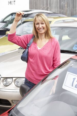 Woman collecting new car photo