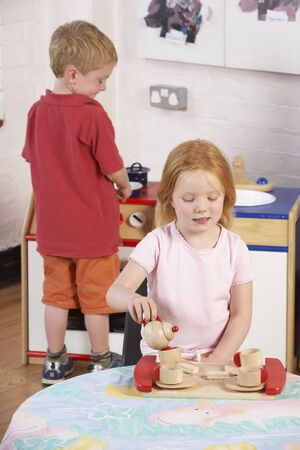 four year olds: Two Young Children Playing Together at MontessoriPre-School