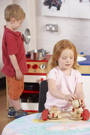 Two Young Children Playing Together at Montessori/Pre-School Stock Photo - 5633086