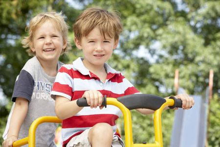 Two Young Boys Playing on Bike photo