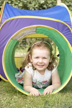 four year olds: Young Girl Crawling Through Play Equipment