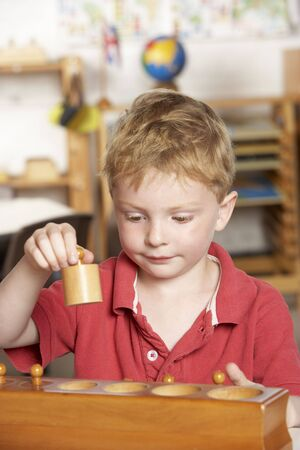Young Boy Playing at Montessori/Pre-School Stock Photo - 5633383