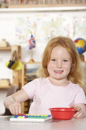 Young Girl Playing at Montessori/Pre-School Stock Photo - 5633206